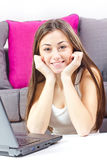 Happy student girl using laptop Stock Images