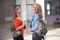 Happy student girls Stock Images