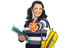 Happy student giving an apple. Happy student woman giving you a red apple isolated on white background Royalty Free Stock Photography