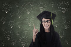 Happy student graduate in front of light bulbs drawing Royalty Free Stock Photography