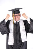 Happy student graduating. A graduating student dressed in cap and gown celebrating his success Stock Photography