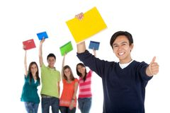 Happy student with a group Royalty Free Stock Images