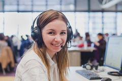 Happy student. With headphones and computer in university Royalty Free Stock Photography