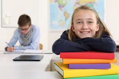 Happy student in her classroom Stock Photography