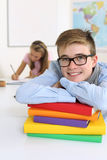 Happy student in his classroom Stock Photo