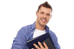 Happy student holding books. Happy male student holding books, smiling Royalty Free Stock Photo