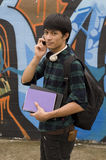 Happy student holding books with backpack. Asian teenage student holding books Stock Photo