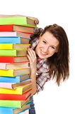 Happy student holding pile of books Royalty Free Stock Photography
