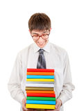 Happy Student holding Pile of the Books. Isolated on the White Background Stock Photo