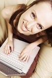 Happy student at home with laptop Stock Photography