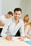 Happy student learning in class Stock Photography