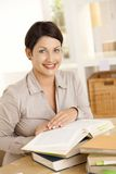 Happy student learning at home Stock Image
