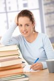 Happy student learning at home smiling Royalty Free Stock Image
