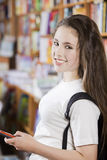 Happy student in library Stock Photos