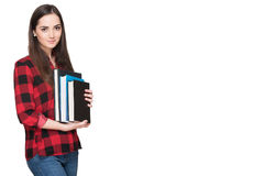 Happy student life. Attractive cheerful young female student holding books, isolated on white Royalty Free Stock Photos