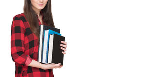 Happy student life. Attractive cheerful young female student holding books, isolated on white Stock Image