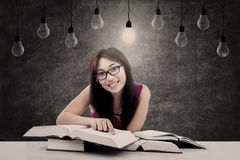 Happy student with lit bulb Royalty Free Stock Photos