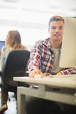 Happy student looking at camera in the computer room Royalty Free Stock Photo