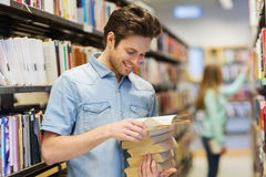 Happy student or man with book in library Stock Photography