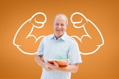 Happy student man with fists graphic standing against orange background Royalty Free Stock Photography