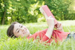 Happy student outdoors relaxed Stock Image