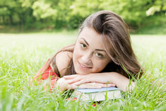 Happy student outdoors relaxed Stock Photo