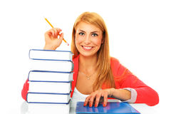 Happy Student. A picture of a young student with books over white background Royalty Free Stock Photography