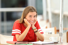 Happy student posing in a coffee shop stock images