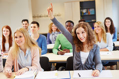 Happy student answering question stock image