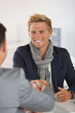 Happy student shaking hand of banker Royalty Free Stock Photography