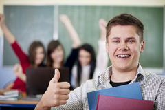 Happy student showing OK Stock Images