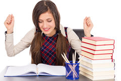 Happy student sitting at desk, hands in the air Stock Photos