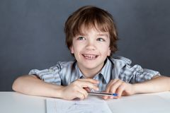 Happy student sitting at desk Royalty Free Stock Photography