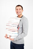 Happy student with a stack of books Royalty Free Stock Photo