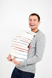 Happy student with a stack of books Stock Images