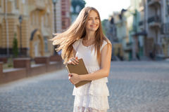 Happy student on street Royalty Free Stock Photos