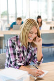 Happy student study in classroom at university Stock Photography