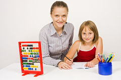Happy student and teacher learning together Stock Image