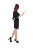 Happy student teenage girl keeps tablet pc standing sideways Stock Photos