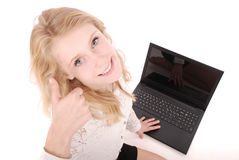 Happy student teenage girl with laptop. Sitting sideways and holding thumb up royalty free stock image
