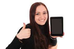 Happy student teenage girl with tablet pc, holding thumb up. Happy student teenage girl with tablet pc. Sitting sideways and holding thumb up. Isolated on white Royalty Free Stock Images