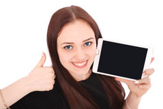 Happy student teenage girl with tablet pc. Sitting sideways and Royalty Free Stock Photos