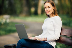 Free Happy Student Teenager Girl Learning With A Laptop Lying In A Bench In An University Campus Royalty Free Stock Image - 91751376