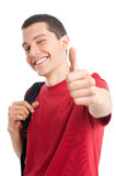 Happy student thumb up. Smiling successful young student showing thumb up isolated on white background Royalty Free Stock Images
