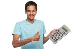 Happy Student with Thumbs Up. Successful happy young man with big calculator Stock Image
