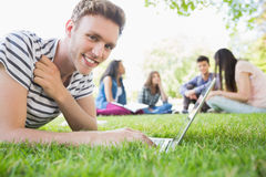 Happy student using his laptop outside Royalty Free Stock Image