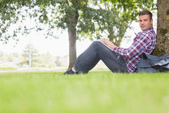 Happy student using his laptop to study outside. On college campus Royalty Free Stock Image