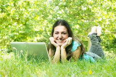Happy student using laptop Stock Photography