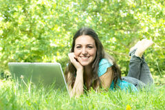Happy student using laptop Royalty Free Stock Images
