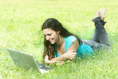 Happy student using laptop Royalty Free Stock Photography